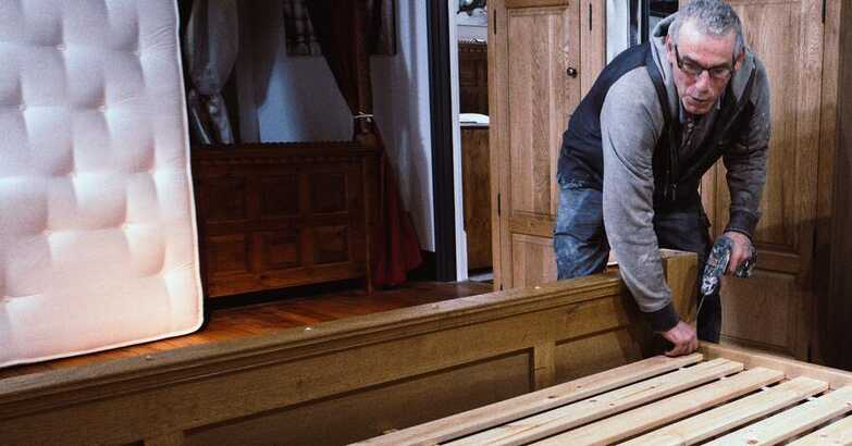Revival Beds team installing a new bed for a customer