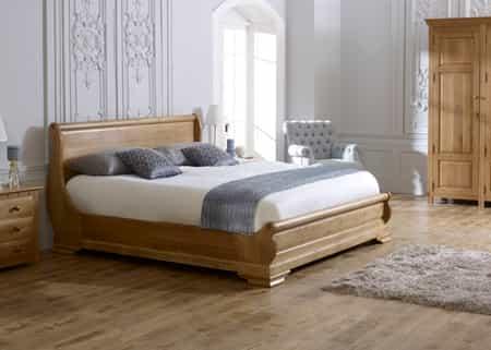 revival sleigh bed oak