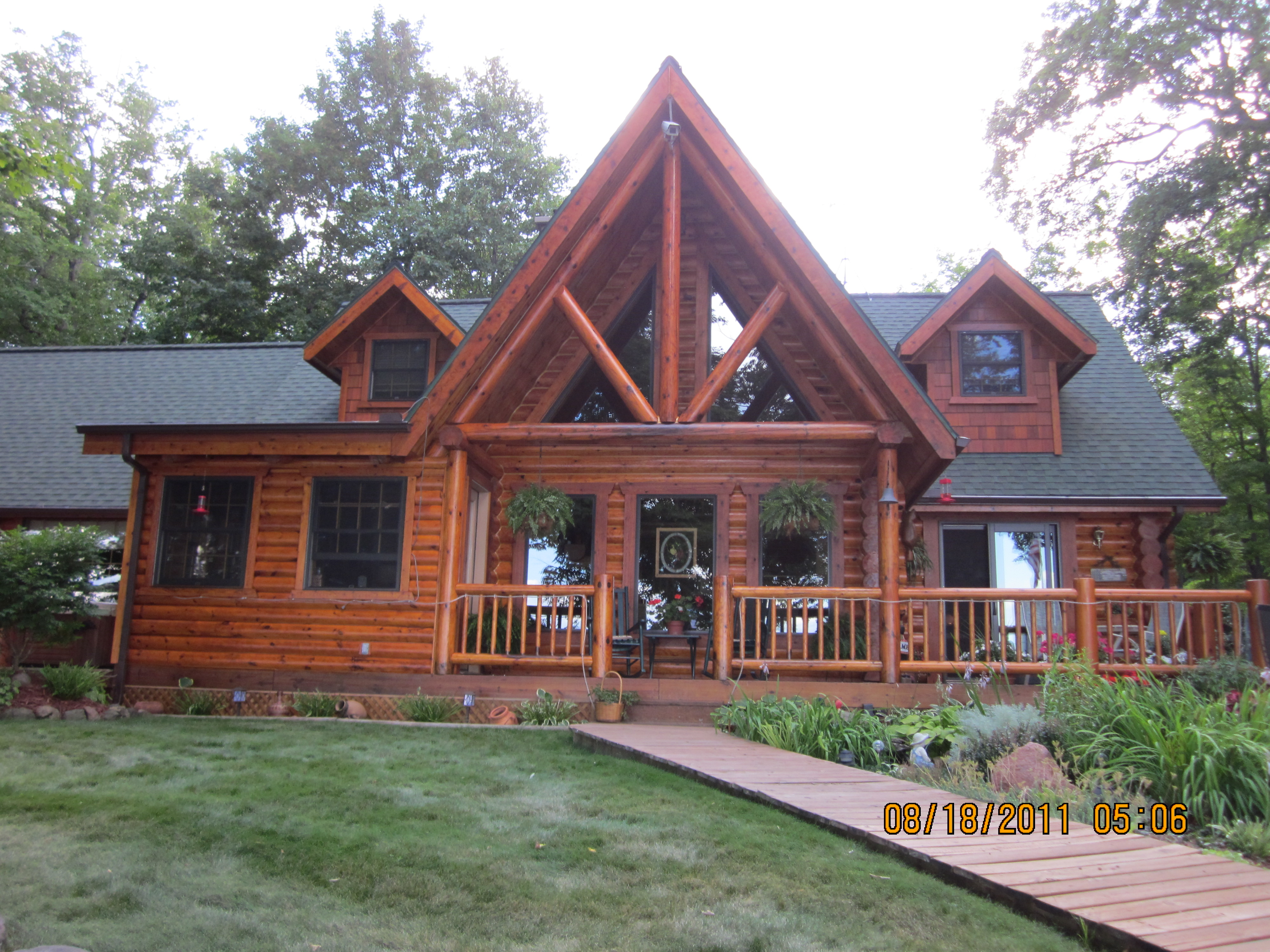 Amazing photo of Log home stain with #965535 color and 4000x3000 pixels
