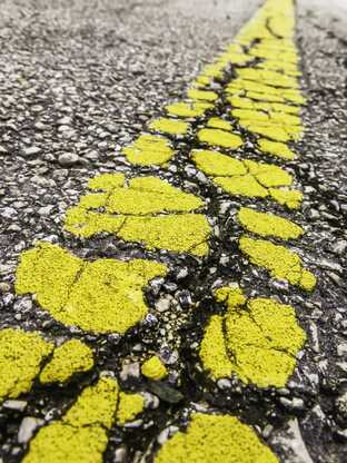 Thoroughly cleaning the surface can make line striping paint stick better