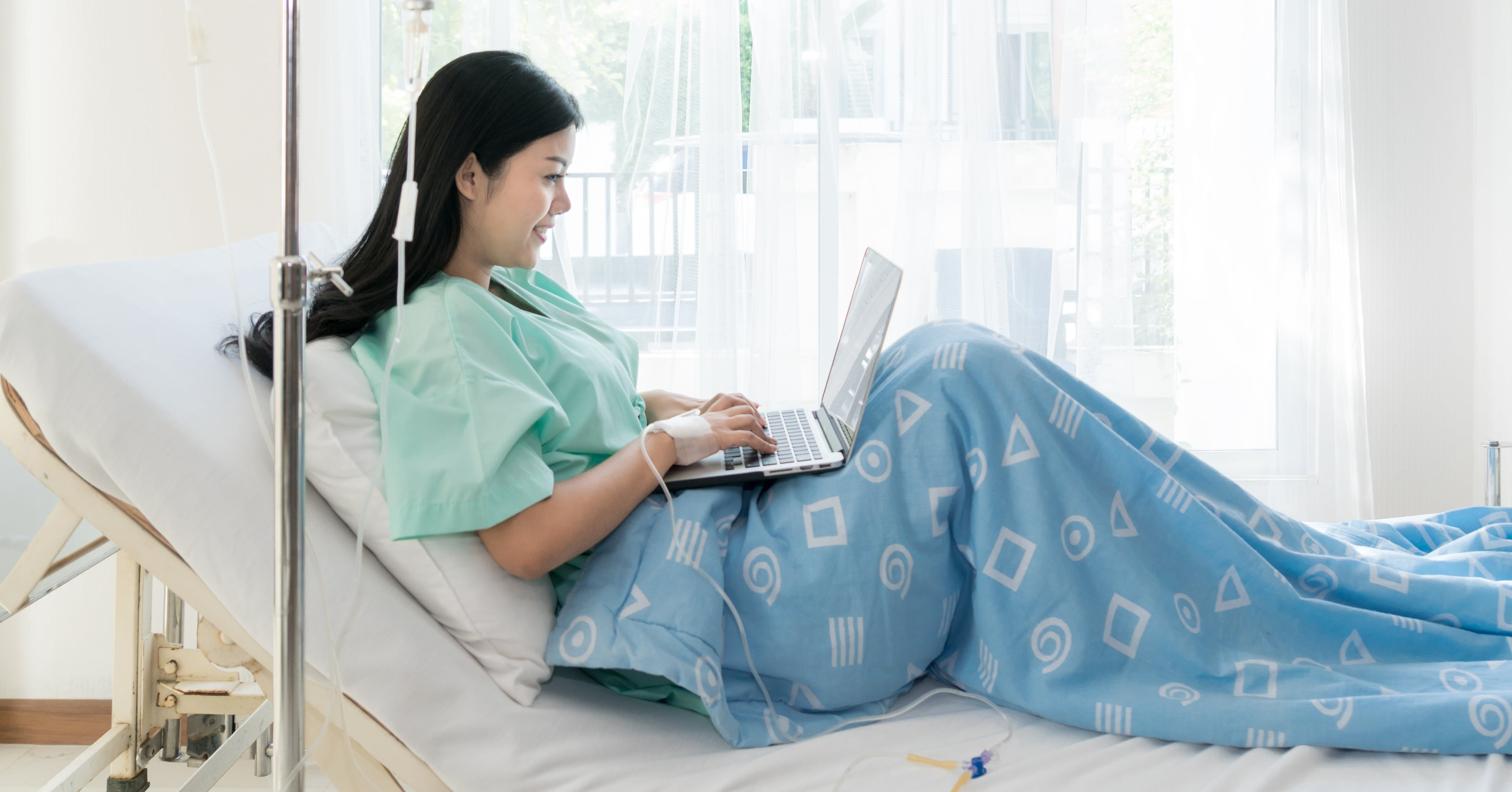 Patient using WiFi in bed