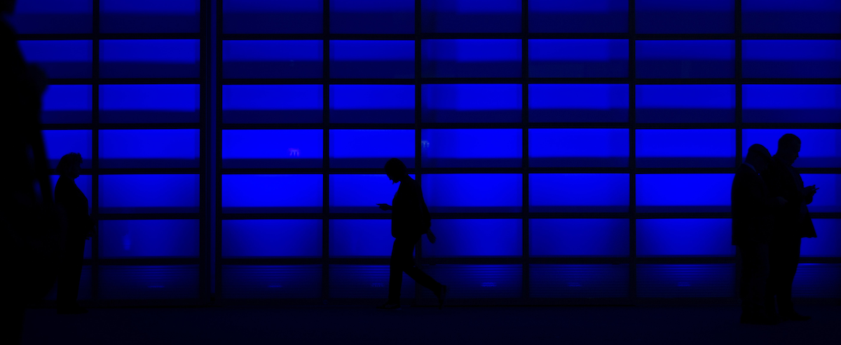people in dark blue office data privacy