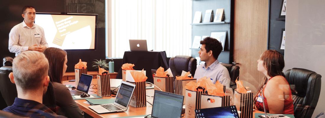 people meeting in office laptops
