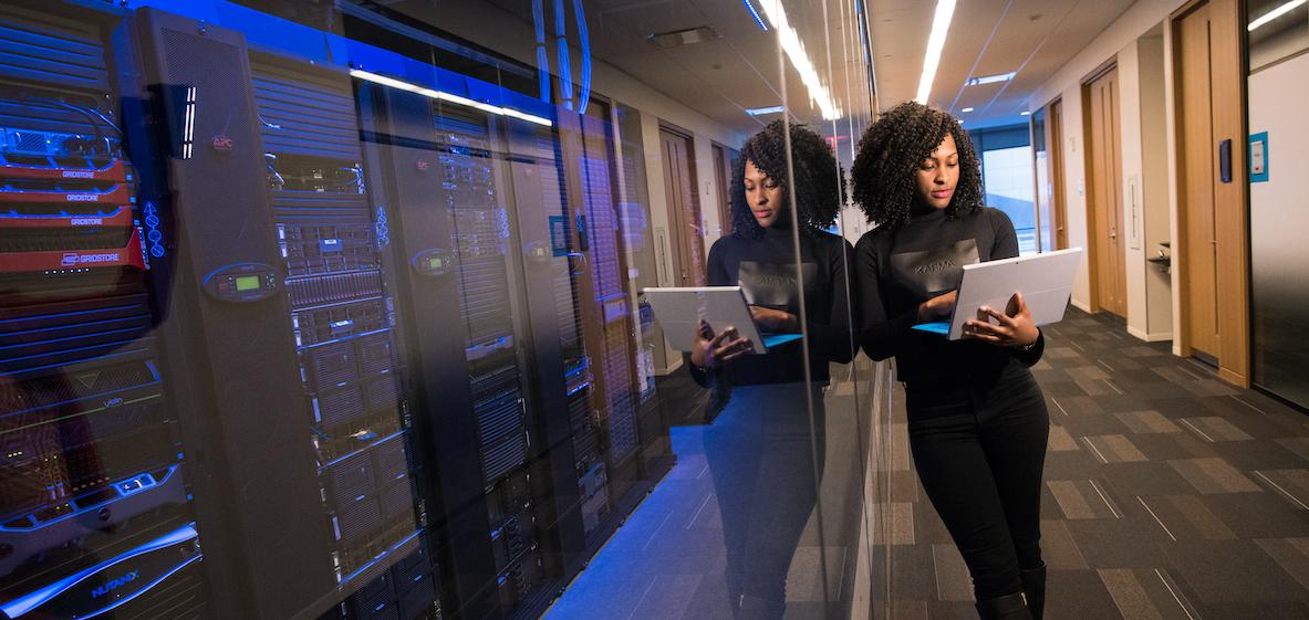 Woman holding laptop glass data center