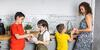 mother and children doing dishes together