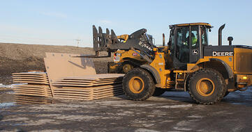 Composite construction mats used with heavy equipment