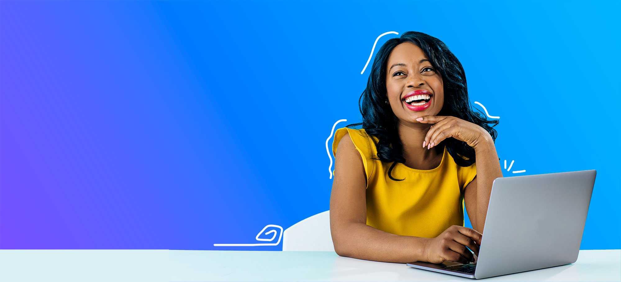 Black woman smiling using laptop