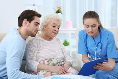 nurse talking with elderly patient