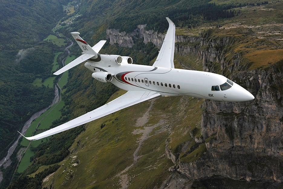 Corporate Aviation - Dassault Flacon 8x flying over cliffs