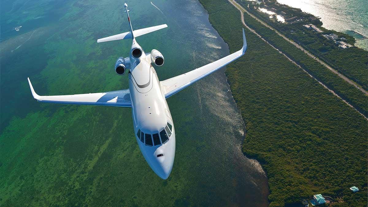 Dassault Falcon 900LX in flight over water