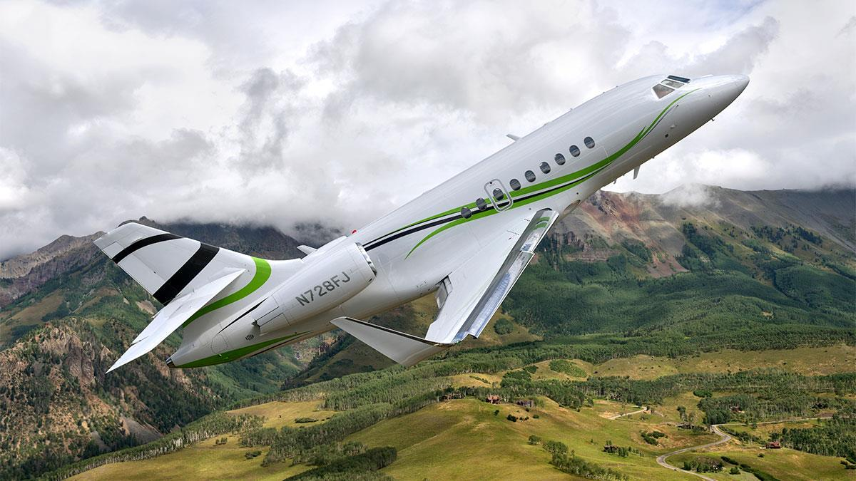 Dassault Falcon 200S flying over mountains