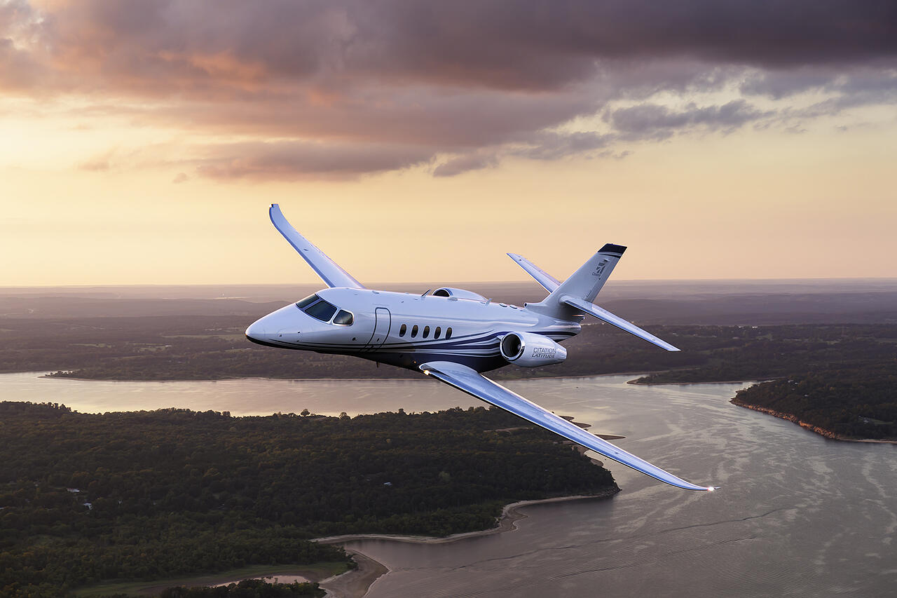 Cessna Citation Latitude private jet flying at dusk