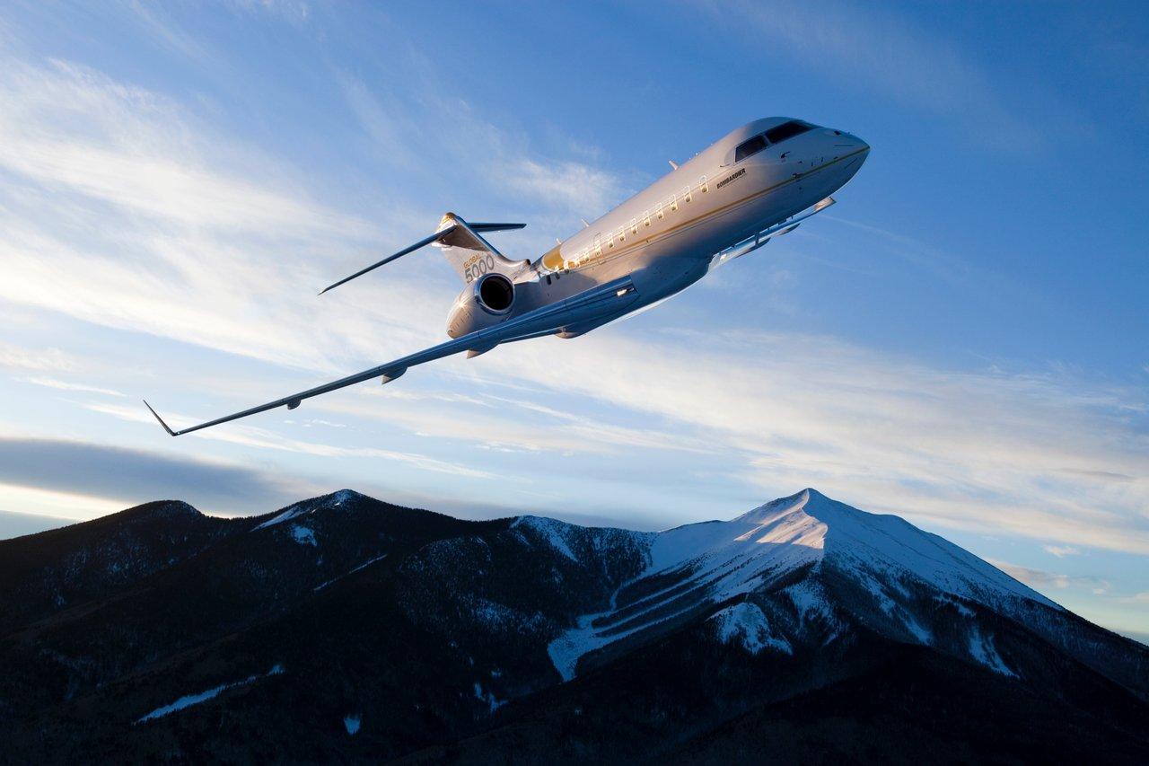 bombardier global 5000 above mountain peak