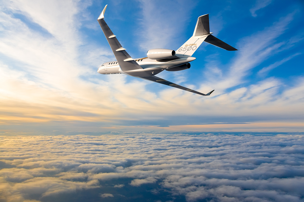 Bombardier global 6500 in flight at sunset