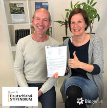 """As former biology students of the University of Regensburg our co-founder & member of management board Dr. Martin Geier and our HR manager Dr. Ulla Gordon are pleased about the """"Deutschlandstipendium"""" scholarship grant from the company Biogents."""