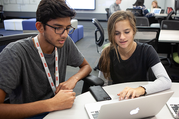 Two student at laptop
