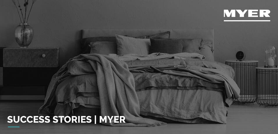 Black and white image of Myer bed with sheets draped over the end