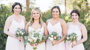 Bridal Party With Classic White Rose Bouquets by Blooming Bouquets at Ocotillo Oasis