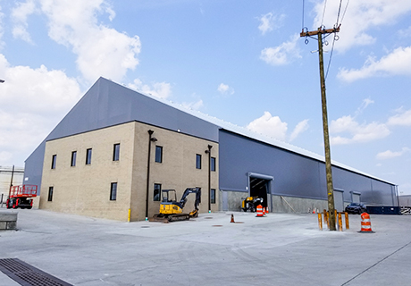 fabric building with brick addition