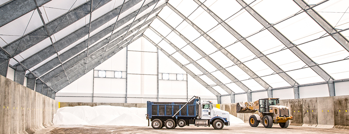 trucks in salt storage building
