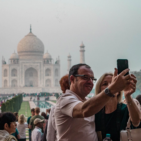 man taking selfie photo with monument