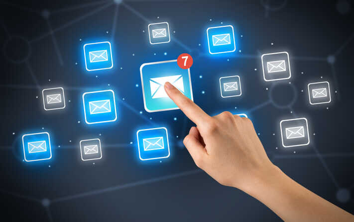 Female hand touching unread mail icon with more envelope icons around it